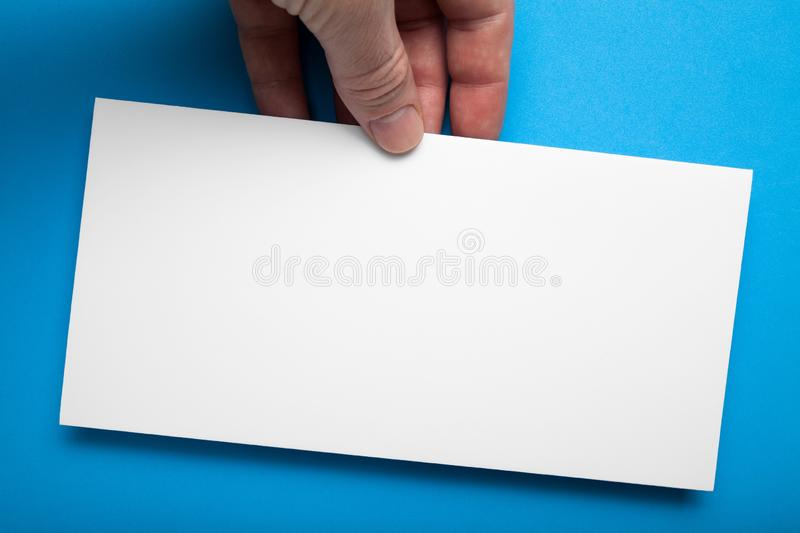 White empty DL Flyer Mock-Up on a blue background.  royalty free stock photos