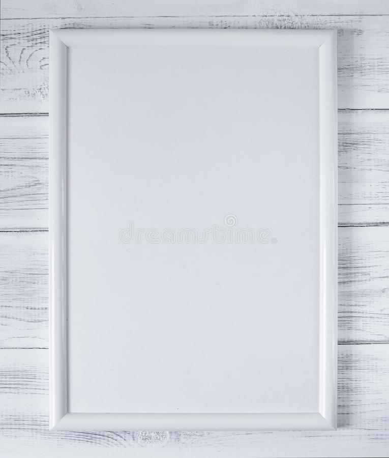 White empty frame on the background of white wooden boards royalty free stock image
