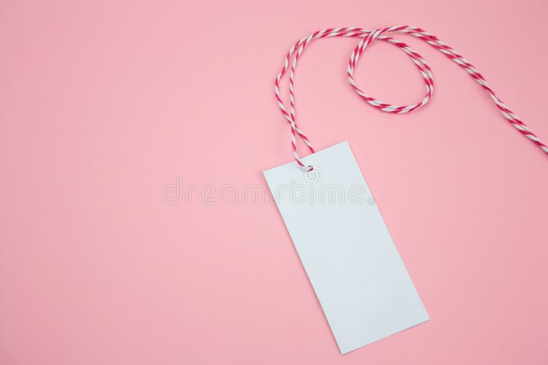 White empty label. On a pastel pink background royalty free stock photos