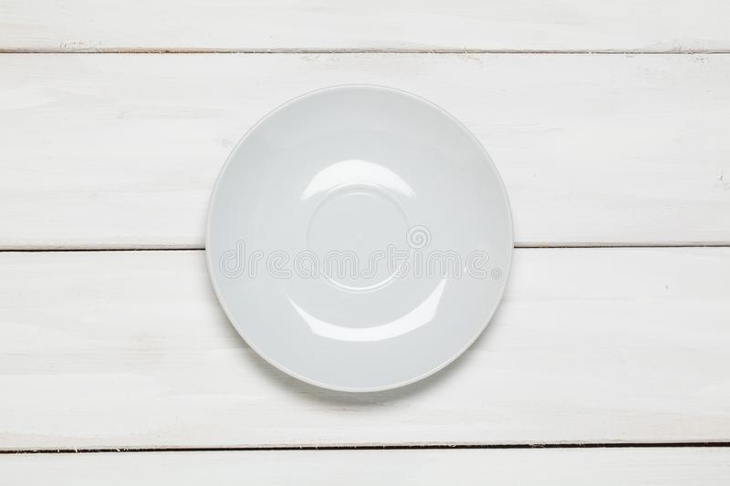 White empty plate on wooden stock photos
