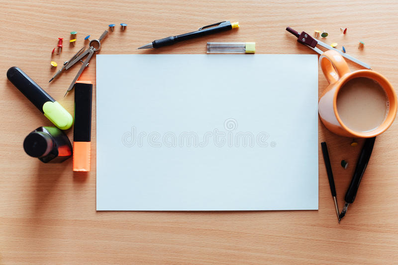 White empty sheet with lots of stationery objects makes. A great copy space for you message or drawing royalty free stock photography