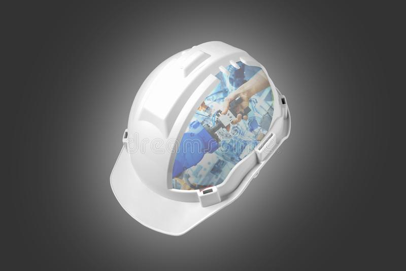 White engineer safety helmet mixed handshake of robotic and human join for teamwork on smart factory royalty free stock photography