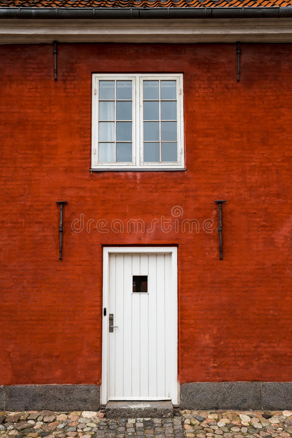 White Entry Door And Window In Red Brick Building Close Up