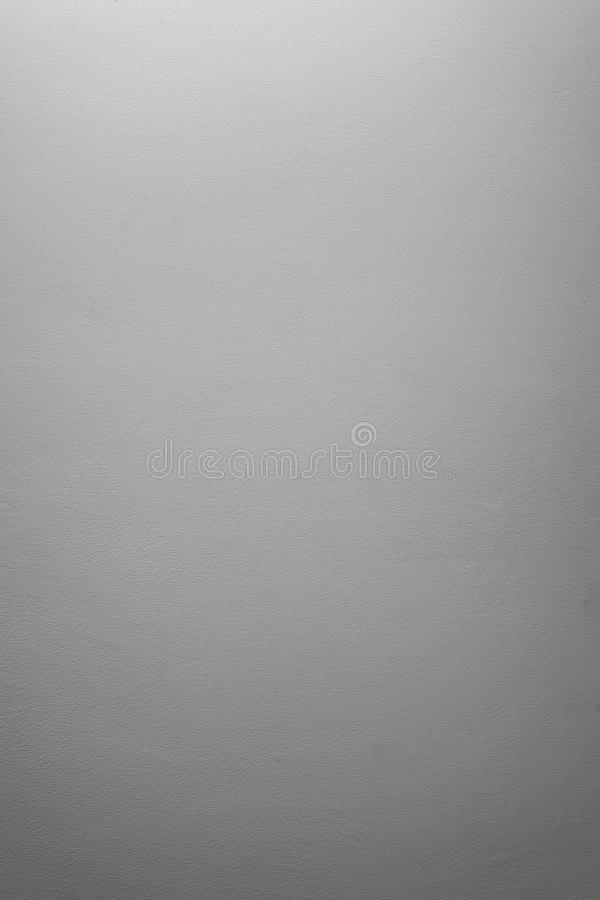 White even cement plaster wall with light gradient. Background photo stock photo