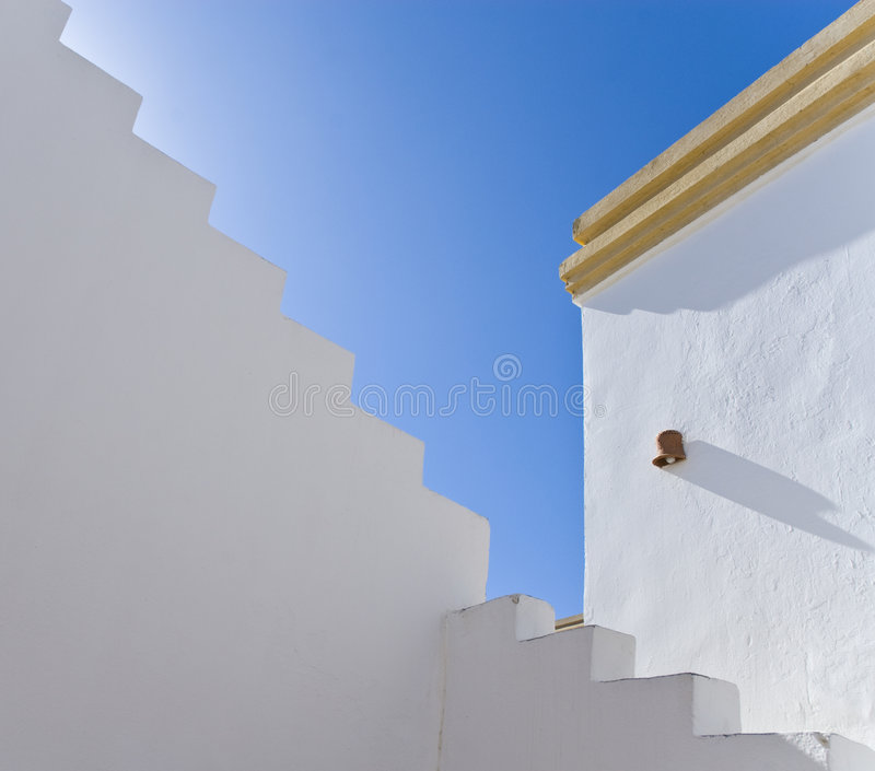 White exterior building walls. A detailed view of white exterior walls of an Egyptian hotel royalty free stock image