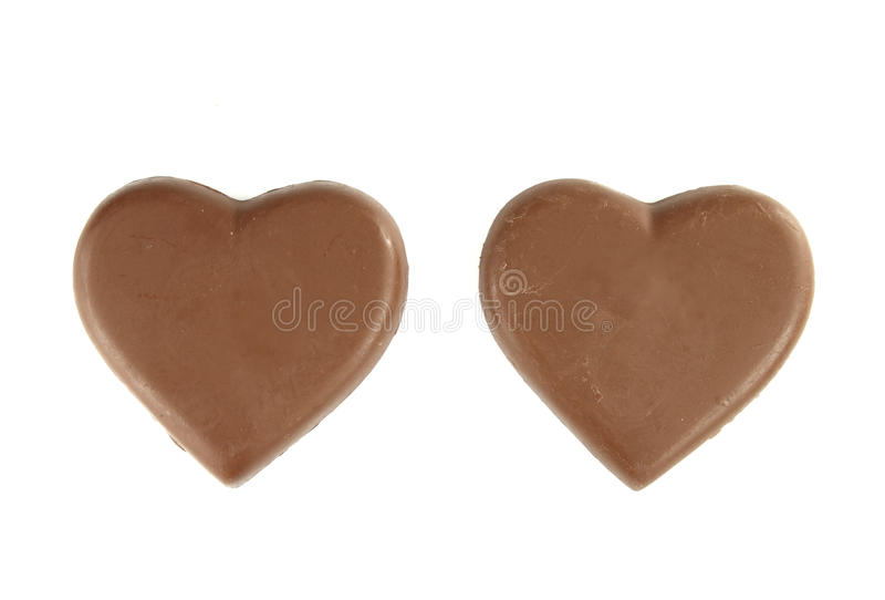 white för chokladhjärtaform arkivbilder