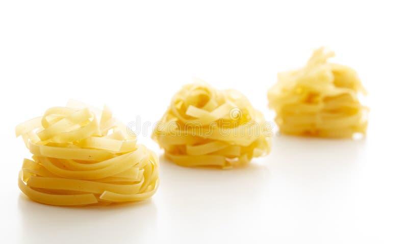 white för italiensk tagliatelle för pasta för bakgrundsmat traditionell fotografering för bildbyråer