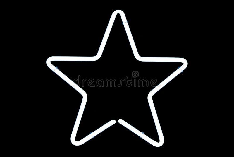 white för stjärna för neontecken fotografering för bildbyråer