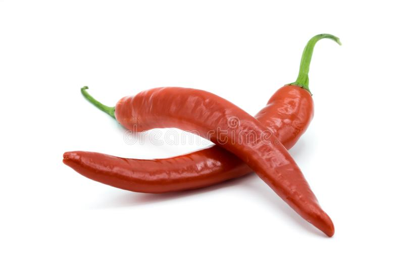 white för varma peppar för bakgrund röd arkivfoton