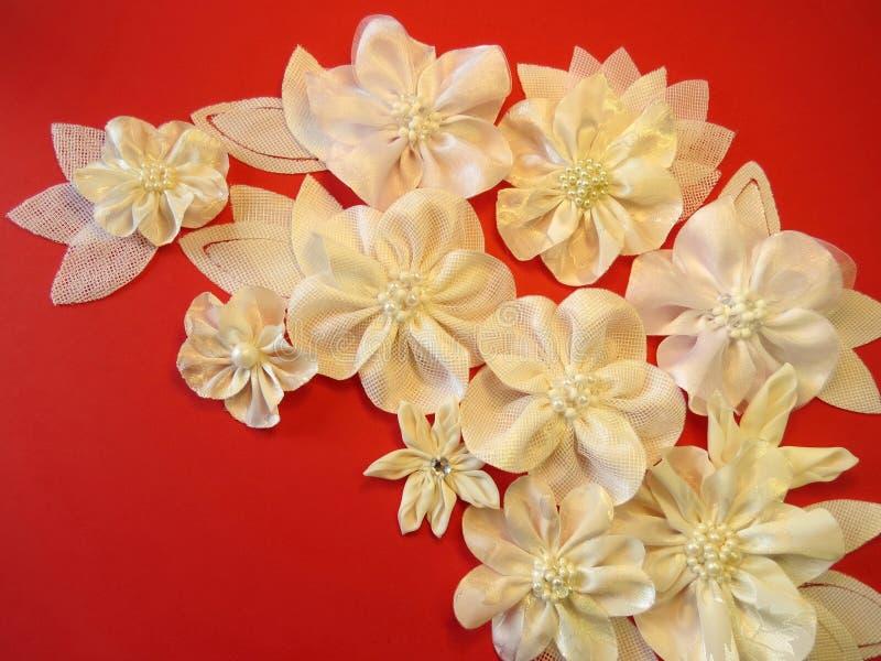 White fabric flowers stock photos