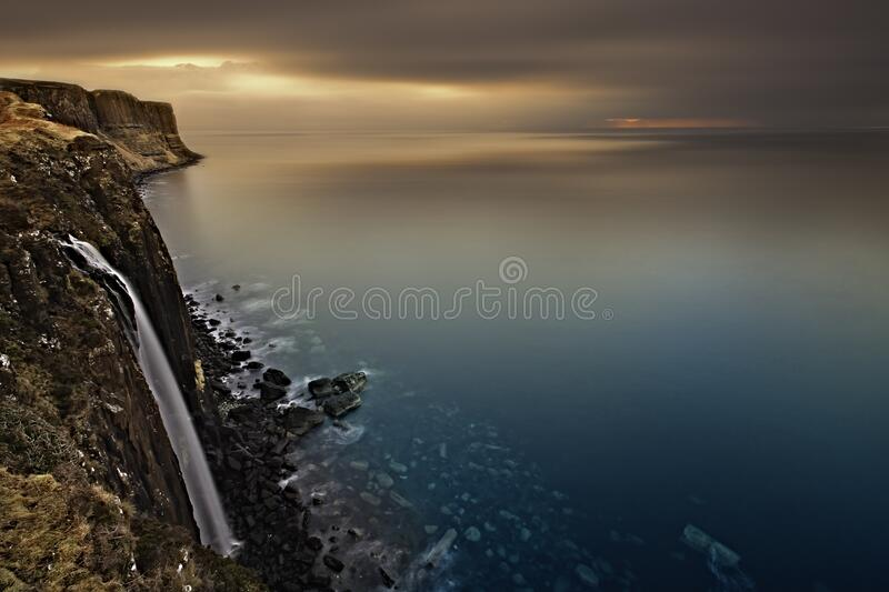 Download White Fabric Hanging On A Cliff Stock Image - Image of ocean, waterfall: 83014493
