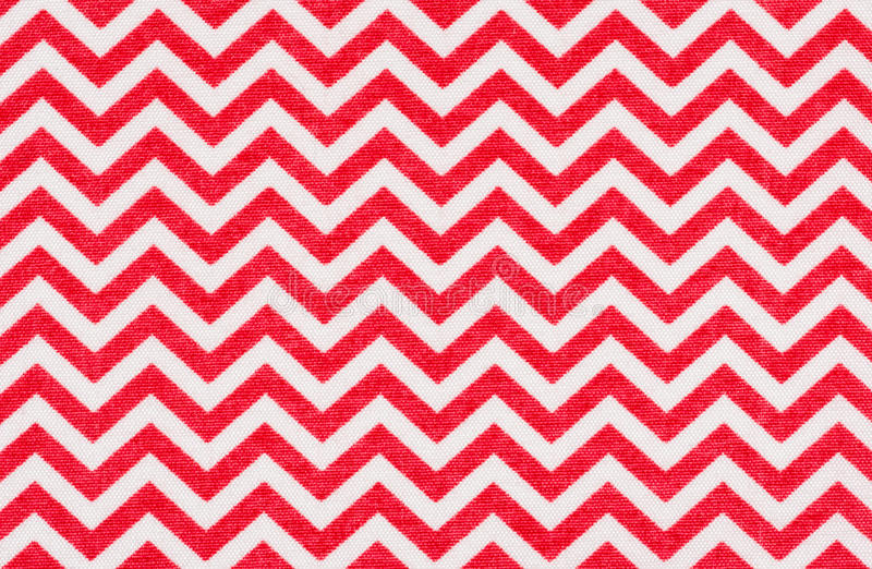 White fabric with a red chevron pattern. A white fabric with a red chevron pattern royalty free stock photos