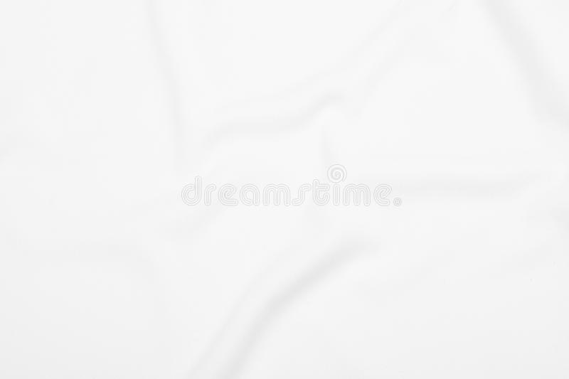 White fabric texture background with soft waves. royalty free stock photography