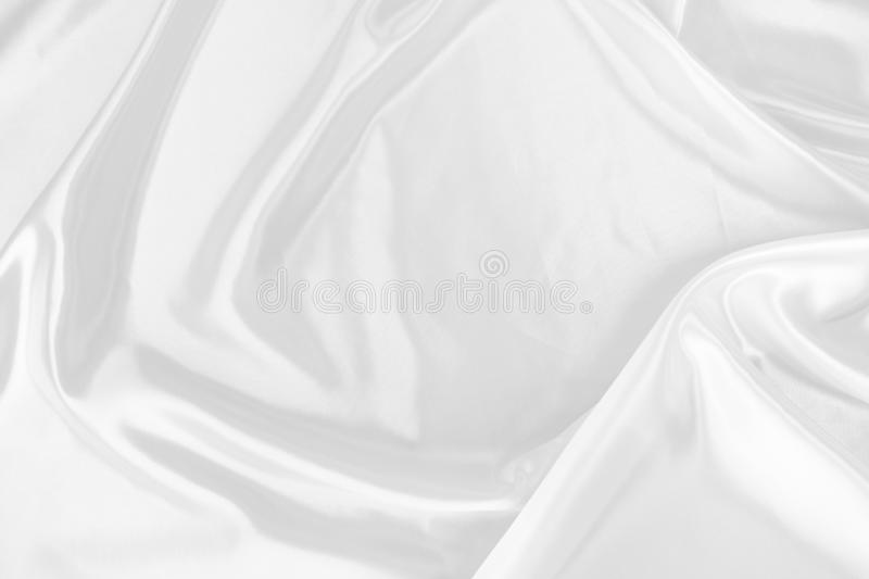 White fabric texture that is white silk background. White fabric texture that is white silk background with beautiful soft blur pattern stock image