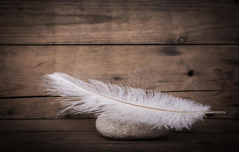 Download White Feather And A Stone On Wooden Dark Background For Mourning Stock Image - Image of dreams, burial: 55433097