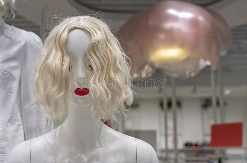White female mannequin in a clothing store. Female dummy stock image