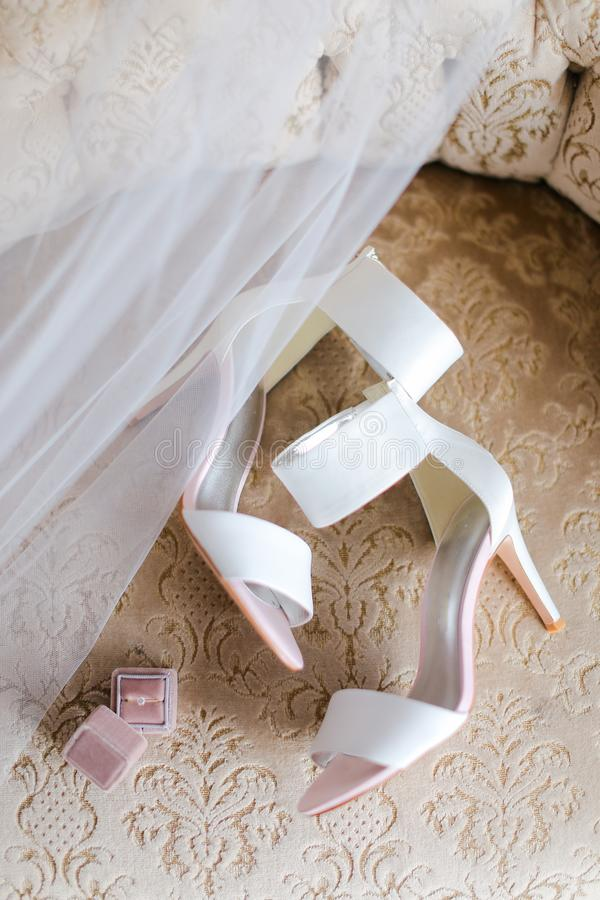 White female shoes and bridal veil. royalty free stock photography
