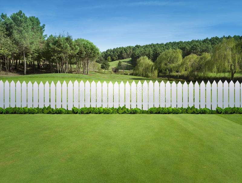 White fences. On green grass royalty free stock image