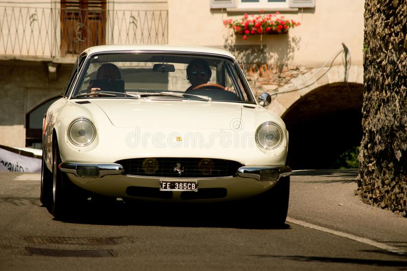 Ferrari 335 GTC at Bergamo Historic Grand Prix 2017. A white Ferrari 335 GTC by Orlando Redolfi going down trough Boccola street in Citta` Alta the medieval part stock image