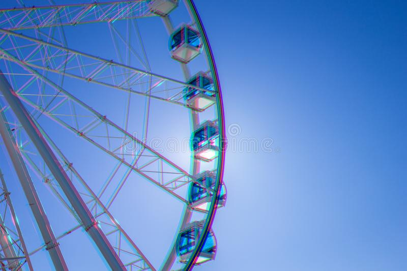 White Ferris wheel with glass cabins against blue sky, Helsinki, Finland. Anaglyph, glitch shifted effect.  royalty free illustration