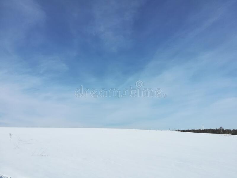 White field of snow. Winter and blue sky. royalty free stock images