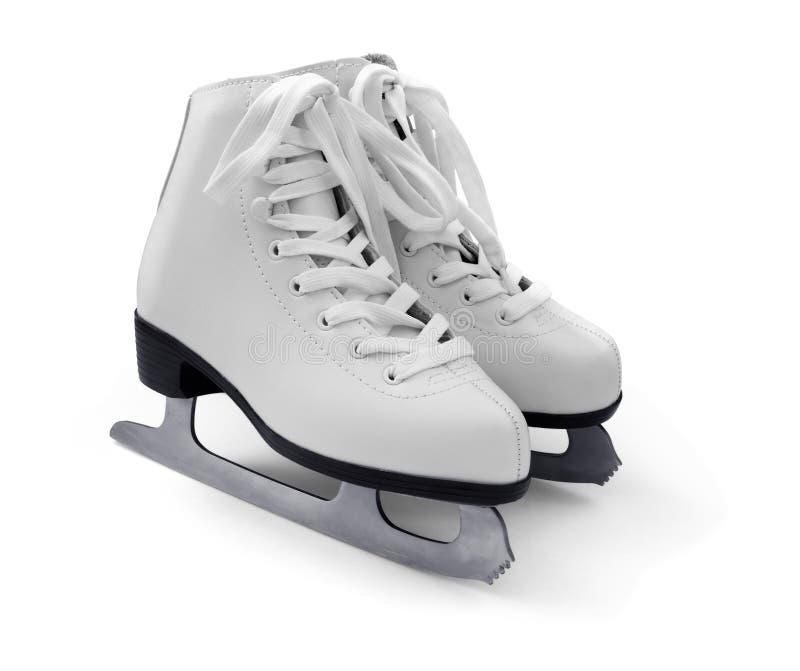 White figure ice skates. Pair of women's white figure ice skates isolated on white stock photos