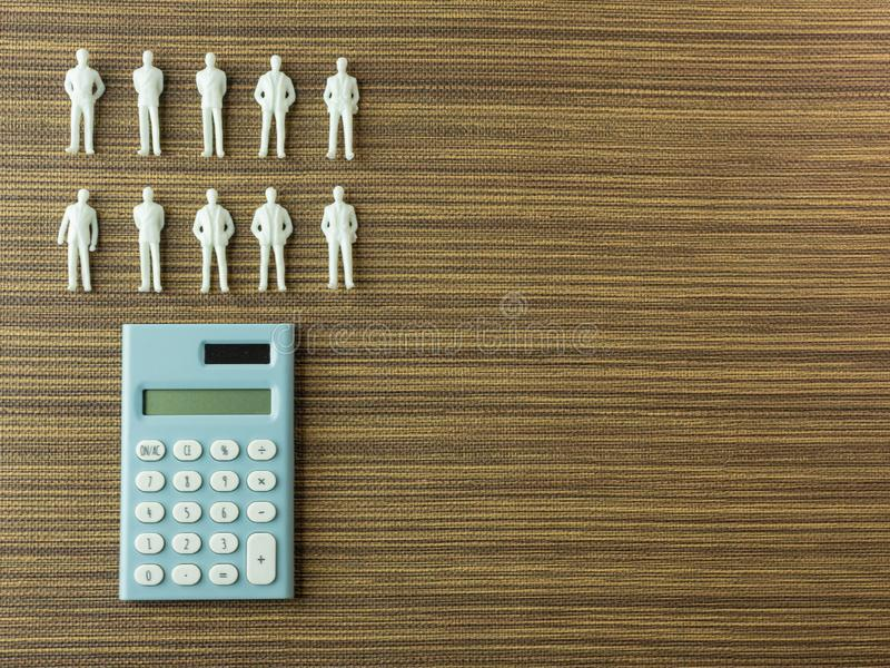 White figure miniature  on wood for business content royalty free stock photography