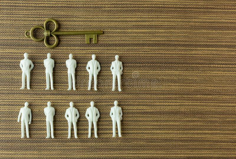 White figure miniature  on wood for business content royalty free stock photo