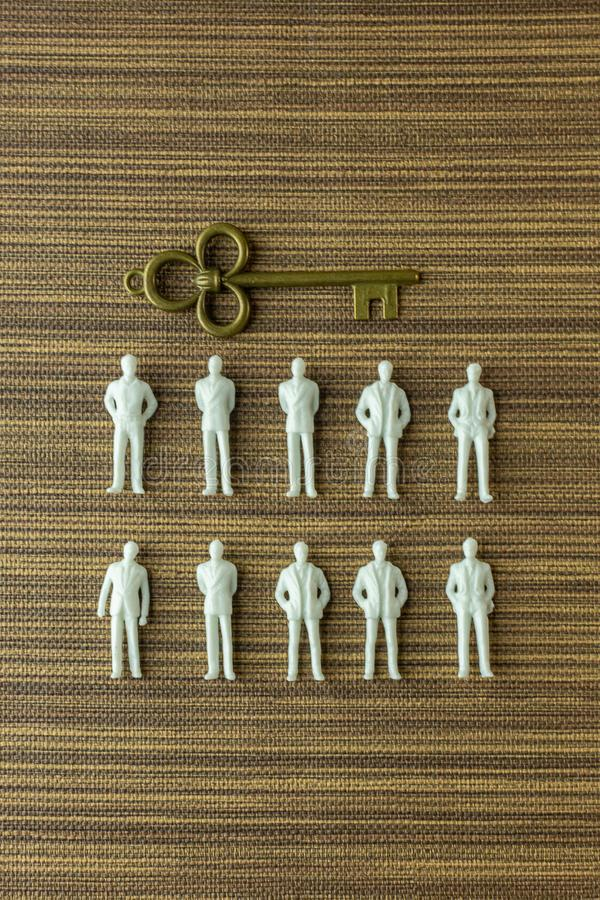 White figure miniature  on wood for business content royalty free stock image
