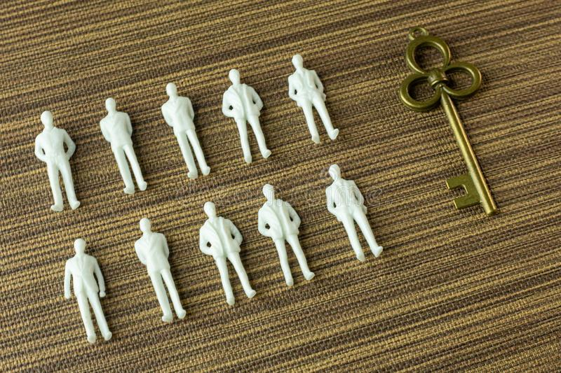 White figure miniature  on wood for business content stock images