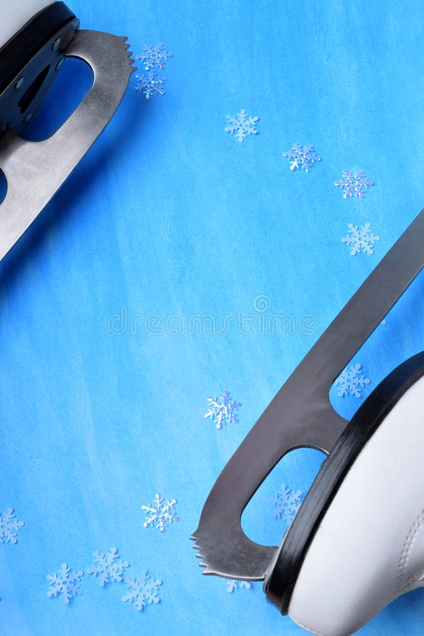 White figure skate against the blue background. Copy space stock image