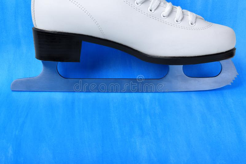 White figure skate against the blue background. Copy space royalty free stock images