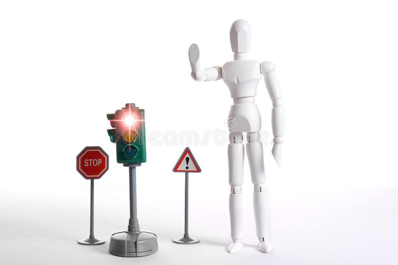 White figure stop. White figure with a symbolic stop gesture and danger symbol poles royalty free stock photos