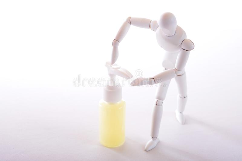 White figure with soap. White figure who wants to let soap out of a soap dispenser on her hand stock images