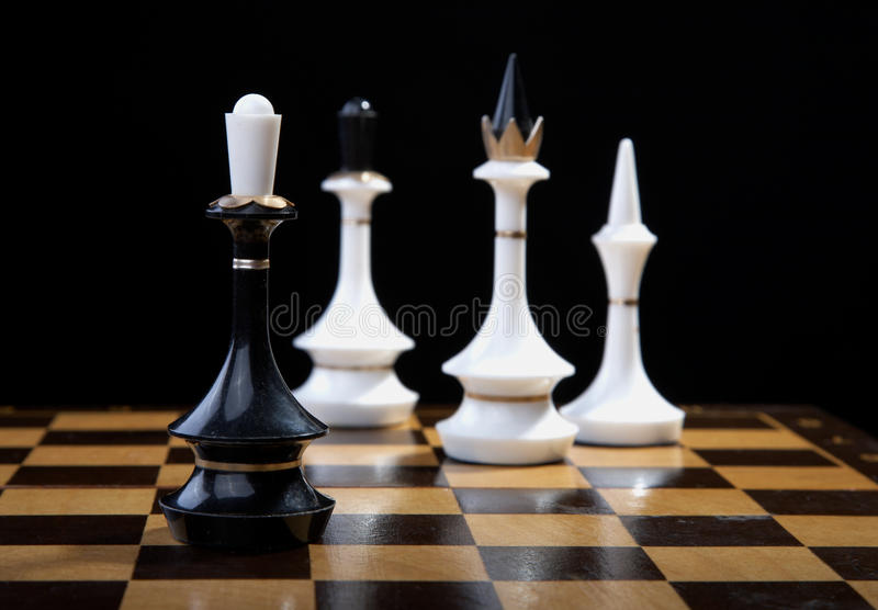 White figures checkmate to king. On a black background stock images