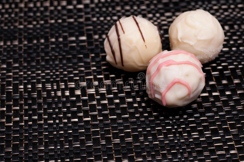 Download White Filled Chocolates On A Dark Cloth Stock Image - Image: 25317901