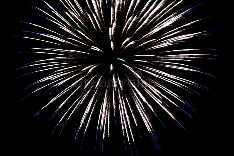 White fireworks with blue sparks on an isolated black background for design decoration of the holidays, the new year, as well as i. Ndependence day on July 4 stock images