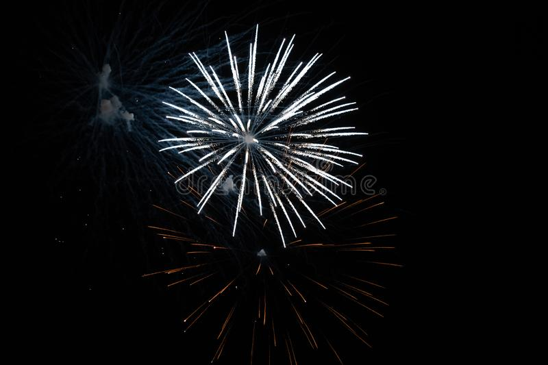 White fireworks display during the night stock photo