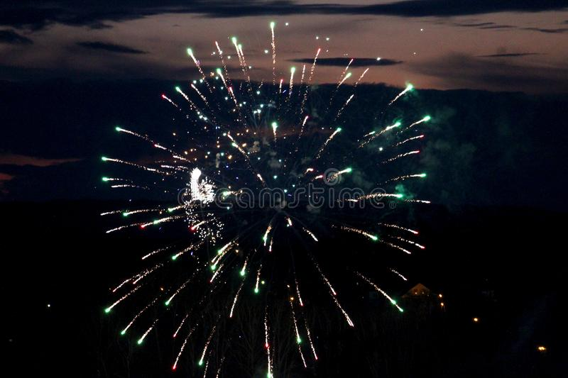 White fireworks show the magic of fire in the night sky. The image shows a ball crown. Beautiful holiday background royalty free stock photos