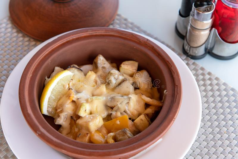 White fish baked with potatoes and a cheese royalty free stock images