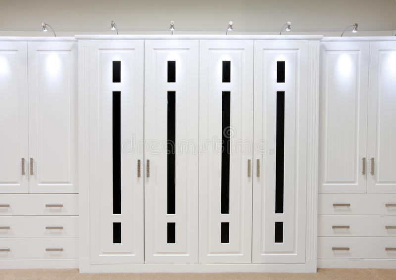 White fitted wardrobe doors. White designer fitted bedroom wardrobe doors and draws stock image