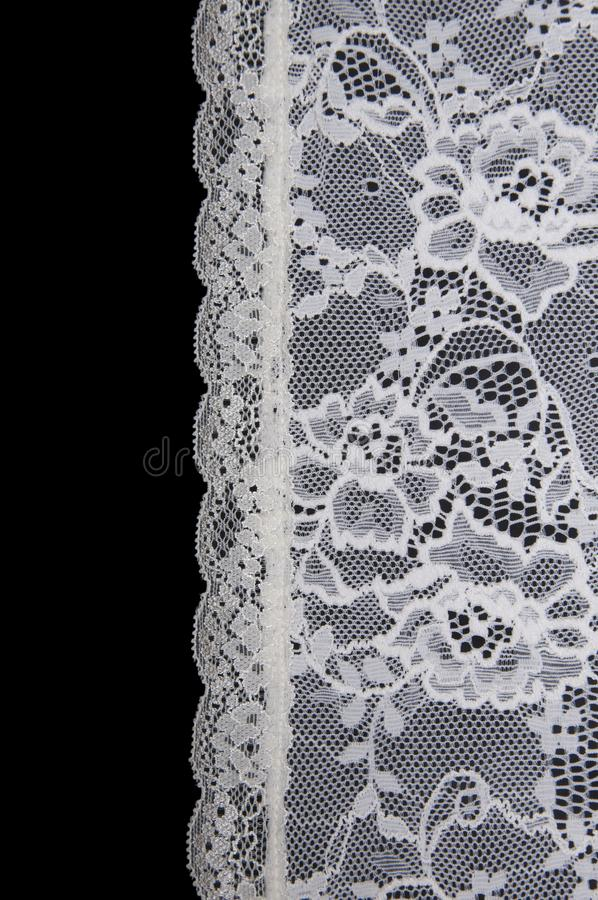 White floral lace on a black. Background stock photos