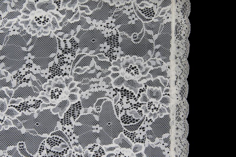 White floral lace on a black. Background stock photography