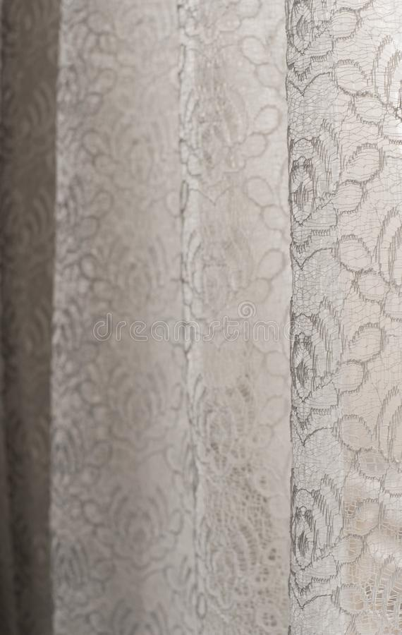 White floral lace curtains - selective focus - background, abstract. White floral lace curtains with selective focus - background, abstract, pure, purity royalty free stock images