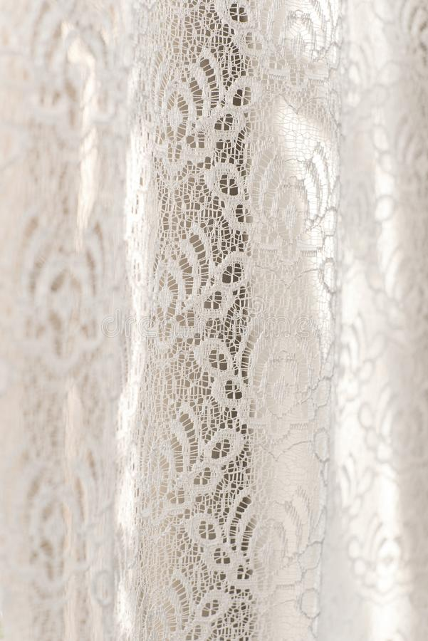 White floral lace curtains - selective focus - background, abstract. White floral lace curtains with selective focus - background, abstract, pure, purity royalty free stock image