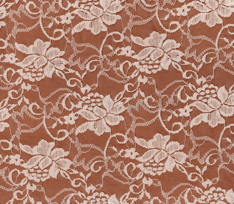 White floral lace on red background. royalty free stock photos
