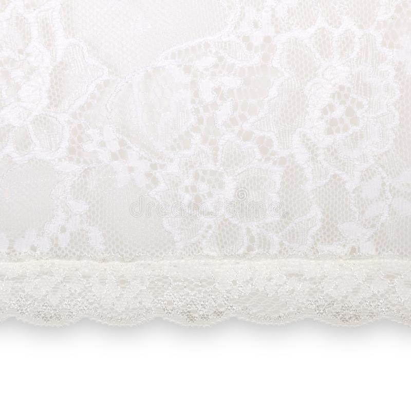 White floral lace on a white. Background royalty free stock photography