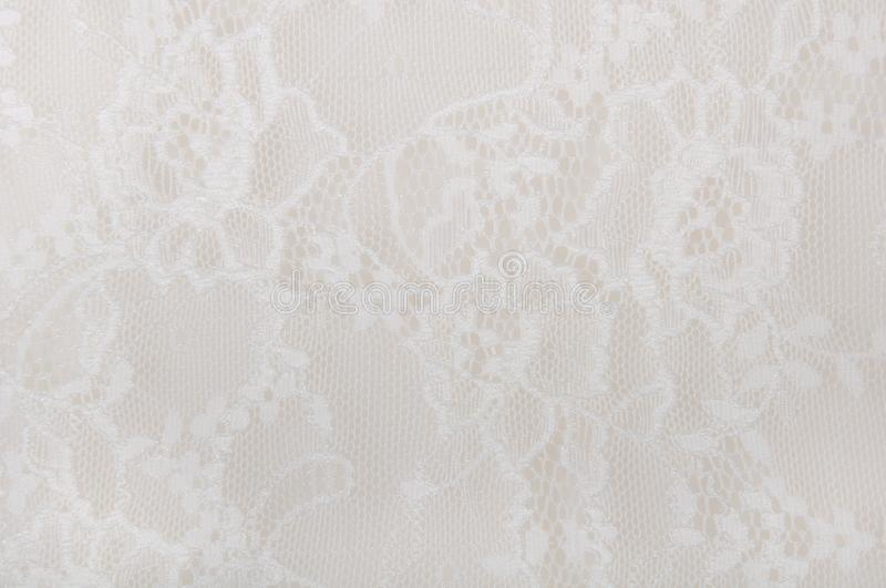 White floral lace on a white. Background royalty free stock image