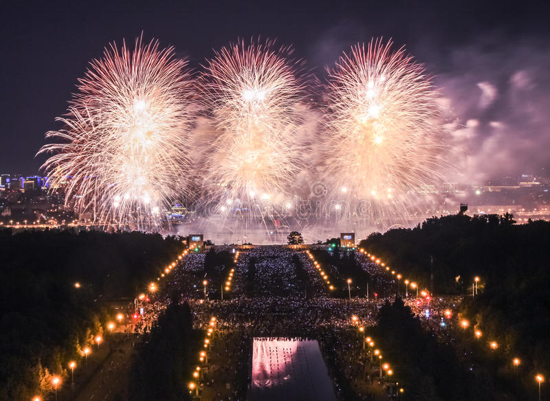White flowers of fire explosions during the International Moscow Firework Festival stock photos