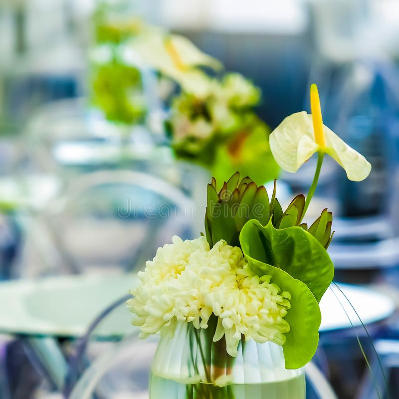 White flowers on a table setting for event or party royalty free stock images
